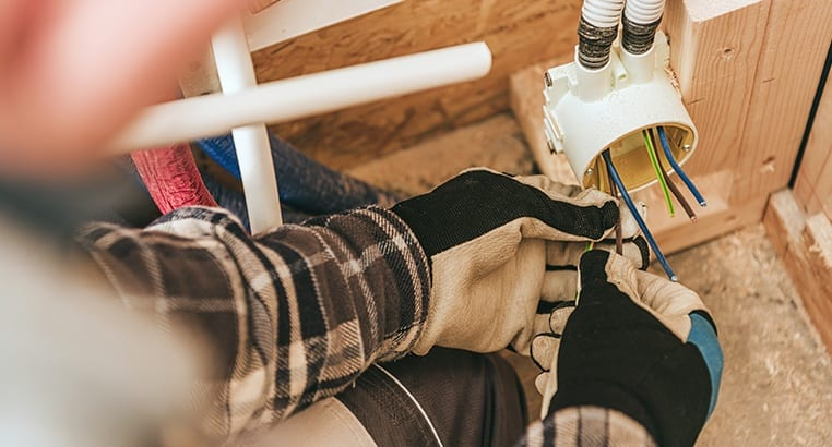 Electrician working on electrical conduit