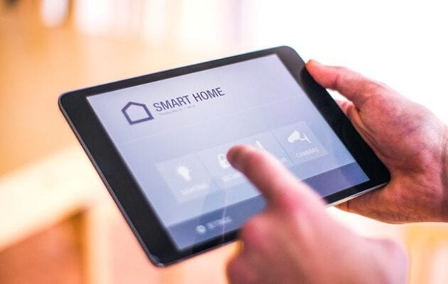 Person interacting with a smart home app on a tablet
