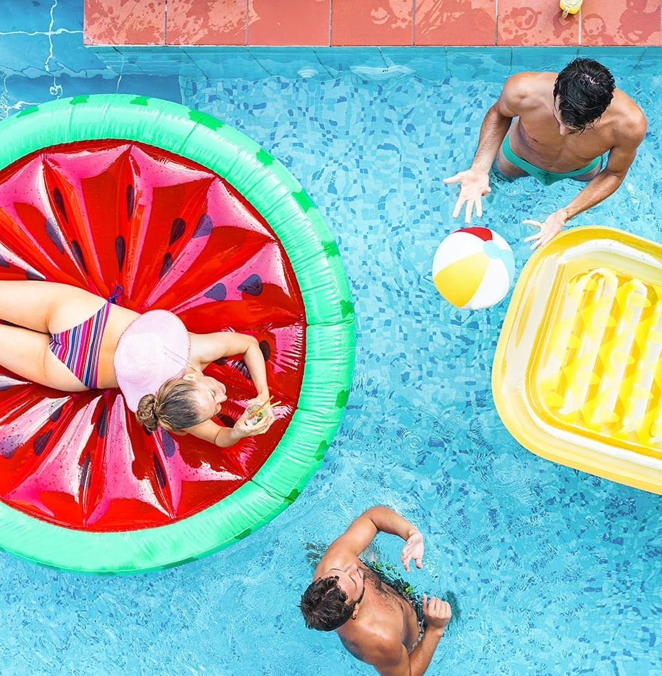 Three people in a pool